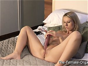 naughty girl unwraps and masturbates her pussy to climax