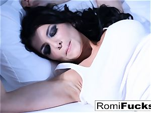 Solo joy on the bed with the big-titted pornographic star Romi Rain