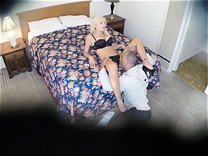 naughty Nina Elle pounds her man at the motel