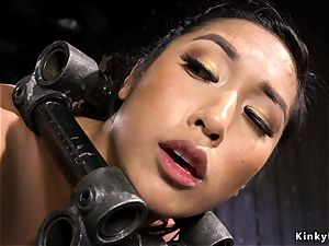 huge-boobed chinese gets bastinado in iron instrument