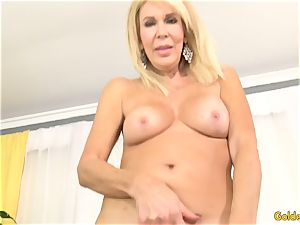 Mature ash-blonde demonstrates off her puss and romps