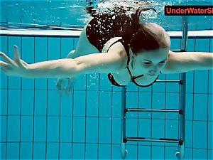 tatted baby swirls underwater