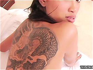 Thai mega-slut with tattoos doggie romping