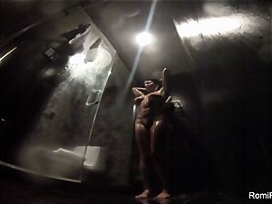 Romi washes off her brilliant body in the douche