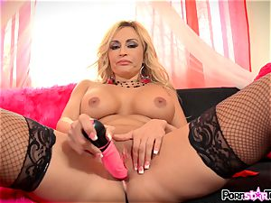 kinky ash-blonde Claudia Valentine messing with her vulva