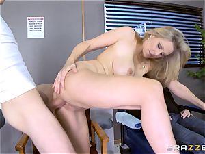 blonde milf Julia Ann sucks a massive hard-on as his fucking partner sleeps